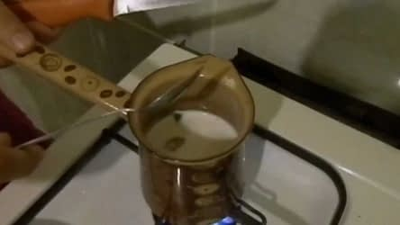 This is the picture of a kettle with milk inside.